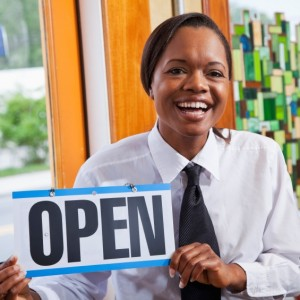 African American woman in restaurant open for business